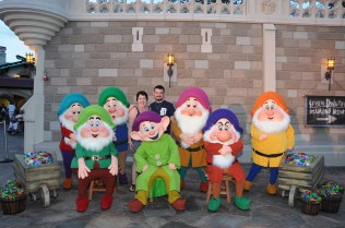 Me and my husband with the Seven Dwarfs during MNSSHP.